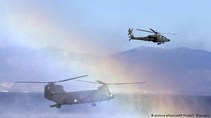 Military helicopters operate during a NATO drill