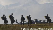 U.S Army soldiers of the 4th Infantry Brigade, Combat team (Airborne) 25th Infantry Division, part of the NATO-led peacekeeping mission in Kosovo during a parachute jump training exercise in U.S military base Camp Bondsteel, near the village of Sojeve in Kosovo on Thursday, Jan. 22, 2015. U.S Army peacekeeping force regularly conducts parachute exercises to maintain proficiency in airborne operations on this deployment in Kosovo. (AP Photo/Visar Kryeziu) |