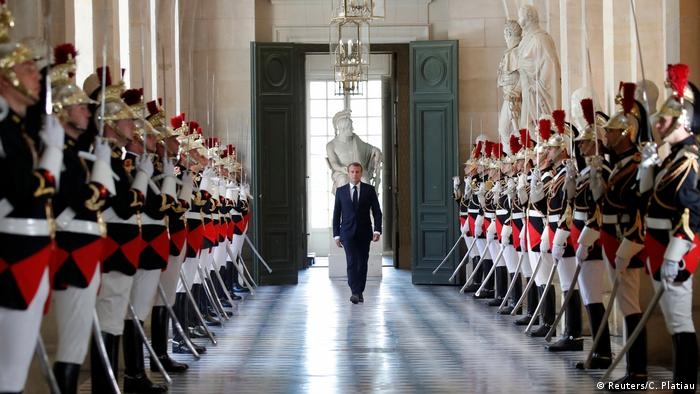 French President Emmanuel Macron walks through the Galerie des Bustes (Bustes Gallery) in Versailles. (Reuters/C. Platiau)