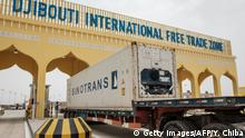 A container truck passes the main gate of Djibouti International Free Trade Zone (DIFTZ) after the inauguration ceremony in Djibouti on July 5, 2018. (Photo by Yasuyoshi CHIBA / AFP) (Photo credit should read YASUYOSHI CHIBA/AFP/Getty Images)