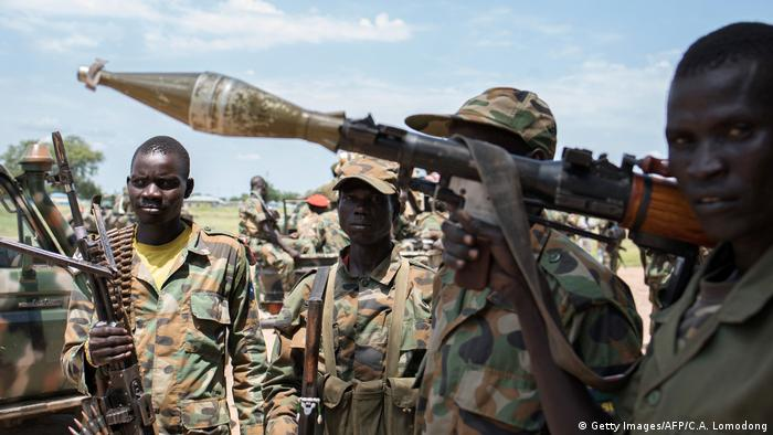 SPLA rebels carrying arms (Getty Images/AFP/C.A. Lomodong)