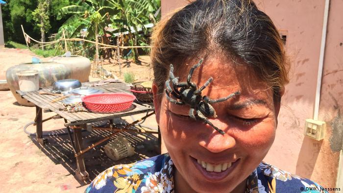 A tarantula crawls over the face of Soy Lon