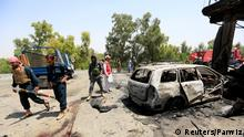 Afghan policemen inspect the site of a suicide attack in Jalalabad city, Afghanistan July 10, 2018. REUTERS/Parwiz