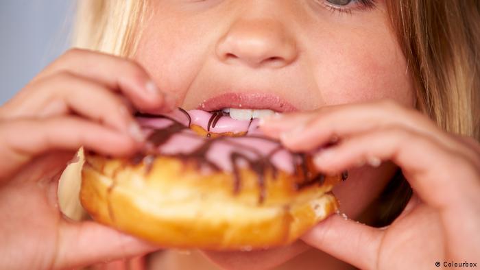 A child eats a donut