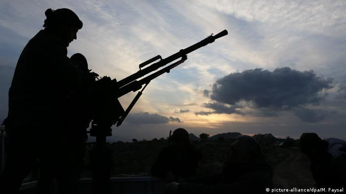 A silhouette of a Free Syrian Army soldier in northern Syria
