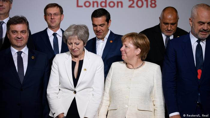 Prime Minister May with Chancellor Angela Merkel and other delegates at the Balkans summit