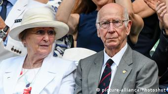 Sir Bobby Charlton with his wife Norma at Wimbledon in 2018