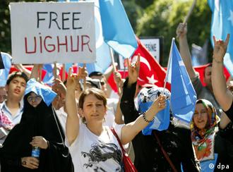 Turkish and Uighur protestors took part in a demonstration in Istanbul after deadly clashes in Xinjiang last year
