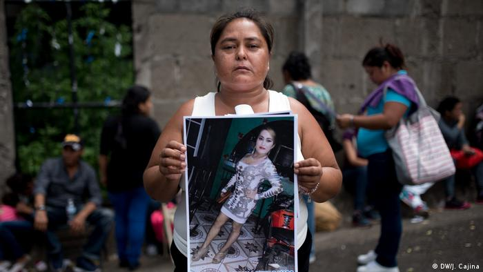 Migdalia Lopez holds a picture of her transgender son, she told DW she feared he would be subjected to rape and torture
