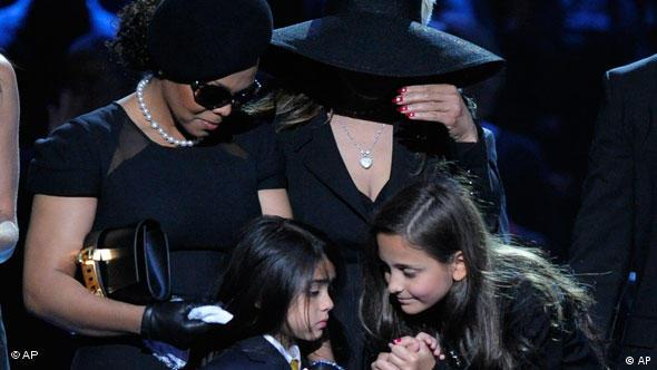 Janet Jackson,left, La Toya Jackson, center, with Michael Jackson's children Prince Michael Jackson II and Paris Jackson during the memorial service for Michael Jackson at the Staples Center in Los Angeles, Tuesday, July 7, 2009. (AP Photo/Mark J. Terrill, Pool)
