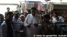 In this picture taken on July 7, 2018, Raza Hayat Hiraj (C), one of the favorite local candidates, cutts a ribbon during the inauguration ceremony of the election office at his constituency during the election campaign in Kabirwala area near Mohri Pur village, where women had previously been banned from voting, some 60 kilometres from Multan, a central city in southern Punjab province. - Men banned women from voting in the village of Mohri Pur sometime around 1947, and they have obeyed ever since -- until this year, when changes to Pakistan's election laws and women's attitudes could shift the dynamic. (Photo by AAMIR QURESHI / AFP) / To go with PAKISTAN-POLITICS-ELECTION-WOMEN, FOCUS by Khurram SHAHZAD (Photo credit should read AAMIR QURESHI/AFP/Getty Images)