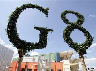 A giant logo made from the leaves of a plant is seen at the G8 summit site in L'Aquila, Italy on Tuesday, July 7, 2009. During a three day meeting beginning on Wednesday, leaders of the Group of Eight will push for common positions on promoting democracy in Iran, combatting climate change and coordinating their exits from huge government stimulus measures. (AP Photo/Virginia Mayo)