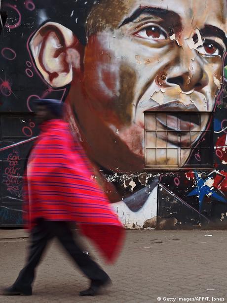 A woman walks past a mural of former US President Barack Obama in Nairobi, Kenya