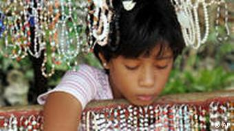 Young girl with lots of necklaces