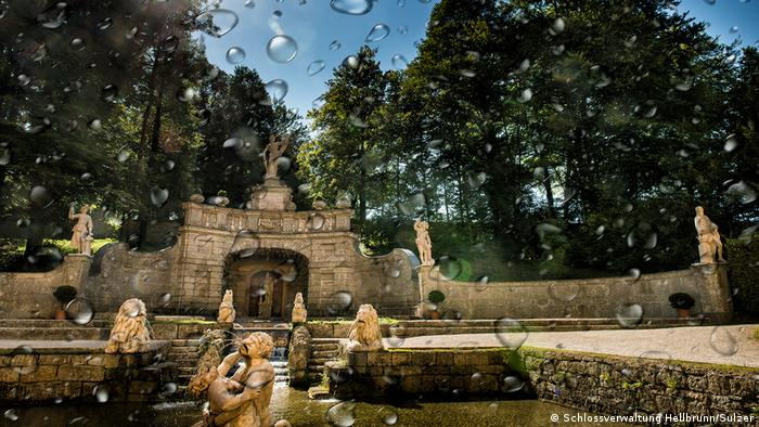 A view of Sternweiher fountain with water droplets on the lens.