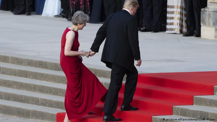 Donald Trump takes Theresa May's hand as they enter Blenheim Palace for dinner during his July 2018 visit to the UK