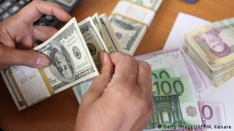 Banknotes: US dollars, euros and Iranian rials (Getty Images/AFP/A. Kenare)