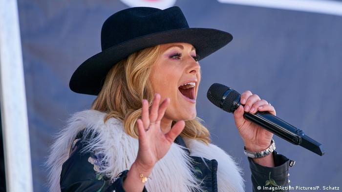 Helene Fischer wearing a black hat