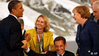 French President Nicolas Sarkozy, center, jokes with U.S. President Barack Obama as German Chancellor Angela Merkel looks on, during a G8 round table session in L'Aquila, Italy, Wednesday, July 8, 2009. The leaders of the Group of Eight nations, united in their desire to work together to fight the worst economic crisis since the Depression, are discussing Wednesday how to coordinate their exit strategies once their economies are stable. (AP Photo/Haraz N. Ghambari)