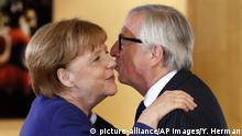 European Commission President Jean-Claude Juncker, right, greets German Chancellor Angela Merkel prior to a group photo at an informal EU summit on migration at EU headquarters in Brussels, Sunday, June 24, 2018. (Yves Herman, Pool Photo via AP) |