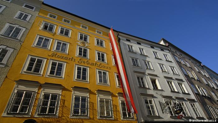 A low-angle view of Mozart's old home, in mustard yellow.