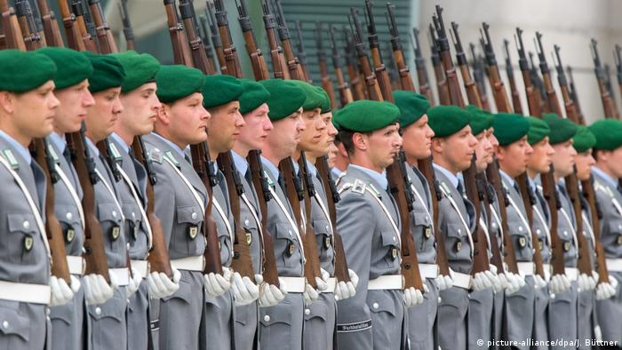 Germany's Bundeswehr soldiers in front of the Federal Chancellery building