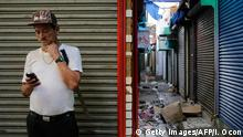 A man with a machete stands guard at the Oriental market in Managua, during a 24-hour nationwide general strike called by the opposition in Nicaragua on July 13, 2018. - A day after five people were killed in violence surrounding protests against Nicaraguan President Daniel Ortega, a 24-hour opposition-called strike began on Friday. (Photo by INTI OCON / AFP) (Photo credit should read INTI OCON/AFP/Getty Images)