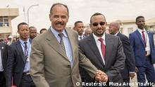 Eritrean President Isaias Afwerki and Ethiopia's Prime Minister Abiy Ahmed and walk together at Asmara International Airport, Eritrea July 9, 2018 in this photo obtained from social media on July 10, 2018. GHIDEON MUSA ARON VISAFRIC/via REUTERS THIS IMAGE HAS BEEN SUPPLIED BY A THIRD PARTY. NO RESALES. NO ARCHIVES MANDATORY CREDIT.