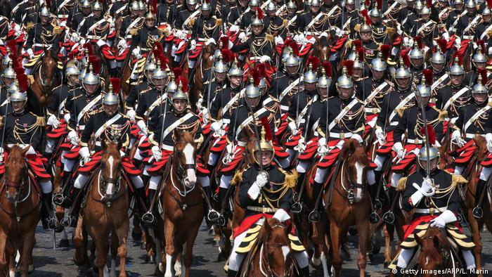 The mounted Republican Guard marches in the Bastille Day parade in Paris (Getty Images/AFP/L. Marin)