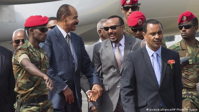Eritrean President Isaias Afwerki is welcomed by Ethiopia's Prime Minister Abiy Ahmed upon his arrival at Addis Ababa International Airport