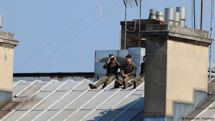 A French soldier uses binoculars to survey the Place de la Concorde (Reuters/G. Fuentes)