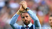 Soccer Football - World Cup - Third Place Play Off - Belgium v England - Saint Petersburg Stadium, Saint Petersburg, Russia - July 14, 2018 England manager Gareth Southgate applauds fans after the match REUTERS/Dylan Martinez