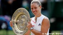 Tennis - Wimbledon - All England Lawn Tennis and Croquet Club, London, Britain - July 14, 2018 Germany's Angelique Kerber celebrates winning the women's singles final with the trophy REUTERS/Andrew Boyers