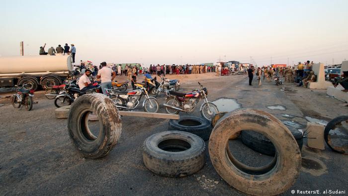 Protesters block the road to Iraq's main Umm Qasr port, south of Basra.