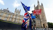 A man holds an anti-Brexit banner on Westminster Bridge in central London (Reuters/Y. Herman)