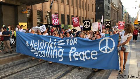 Demonstrators in Helsinki hold a banner that reads: Helsinki calling for peace.