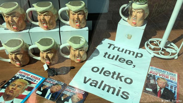 Trump mugs in Finnish shop along with a sign that reads Trump is coming; are you ready?