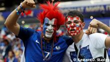 15.7.2018*** Soccer Football - World Cup - Final - France v Croatia - Luzhniki Stadium, Moscow, Russia - July 15, 2018 France fan and a Croatia fan pose for a photo inside the stadium before the match REUTERS/Darren Staples