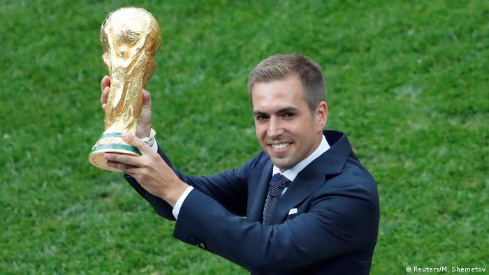 Former Germany captain Philipp Lahm holding the World Cup trophy in Moscow, Russia, in 2018.