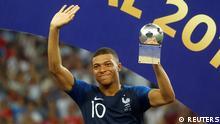 Soccer Football - World Cup - Final - France v Croatia - Luzhniki Stadium, Moscow, Russia - July 15, 2018 France's Kylian Mbappe receives the FIFA Young Player award REUTERS/Kai Pfaffenbach