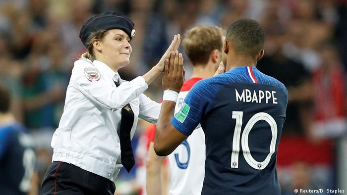 A member of Pussy Riot and France's Kylian Mbappe during the World Cup final, Luzhniki Stadium, Moscow (Reuters/D. Staples)