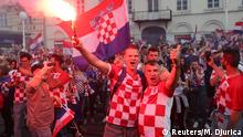 Soccer Football - World Cup - Final - France v Croatia - Zagreb, Croatia - July 15, 2018 - Croatia's fans celebrate after watching the broadcast of the match at the city's main square. REUTERS/Marko Djurica