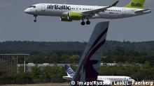 15.07.2018 +++ The Bombardier CS300 of airBaltic flies over the Airbus A220-300 (under which name all C-Series jets will be from July 2018) jet at the Farnborough International Airshow in Farnborough, United Kingdoom. (Photo by Leonid Faerberg / Transport-Photo Images) LeonidxFaerberg PUBLICATIONxINxGERxSUIxAUTxHUNxONLY