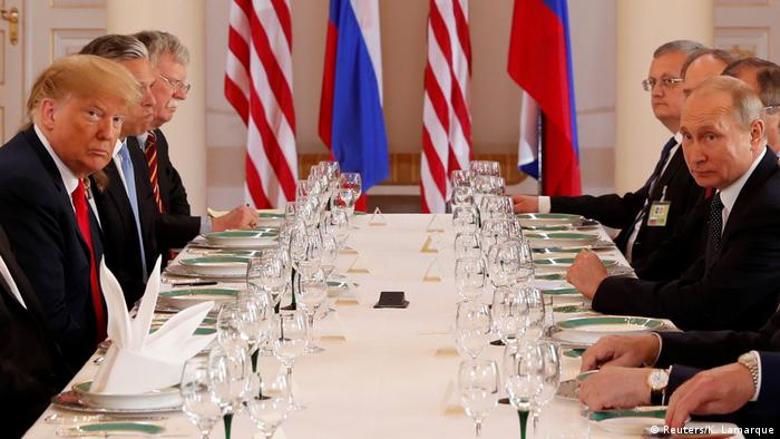 Trump and Putin at a working lunch in Helsinki (Reuters/K. Lamarque)