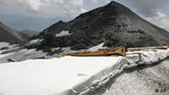 A white fleece is rolled out on the ski slopes on the Vorab glacier in Switzerland