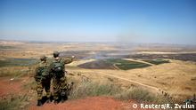 FILE PHOTO: Israeli soldiers look at the Syrian side of the Israel-Syria border on the Israeli-occupied Golan Heights, Israel July 7, 2018. REUTERS/Ronen Zvulun