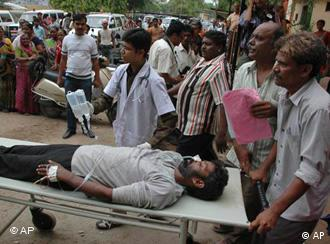 A man who consumed hooch in Ahmedabad is taken to hospital on a stretcher