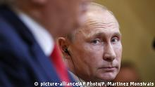 Vladimir Putin at press conference in Helsinki (picture-alliance/AP Photo/P. Martinez Monsivais)