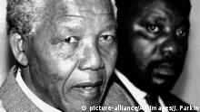 African National Congress President Nelson Mandela, and Secretary General Cyril Ramaphosa, right, criticize Sout African's President F.W. de Klerk's speech at the opening of Parliament at a news conference on Friday, January 24, 1992 in Soweto, Johannesburg, South Africa. (AP Photo/John Parkin) |