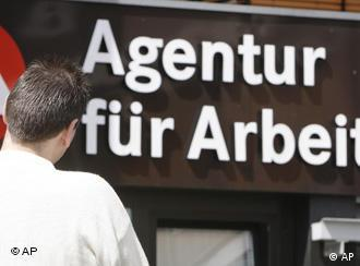 A man stands in front of the German Federal Labor Agency